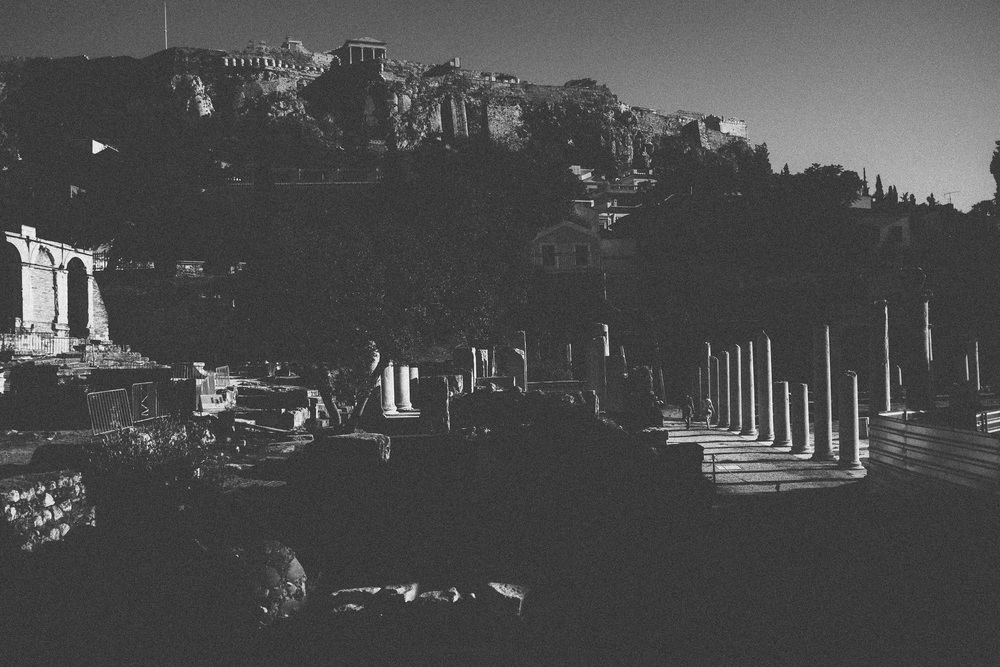 Photo 80.  The Roman Agora catches some light below the Acropolis, bottom right.  The Romans built heavily in Athens, led primarily by the great Emperor Hadrian who sympathized with the ancient Greek traditions.  Athens, Greece, 2014.