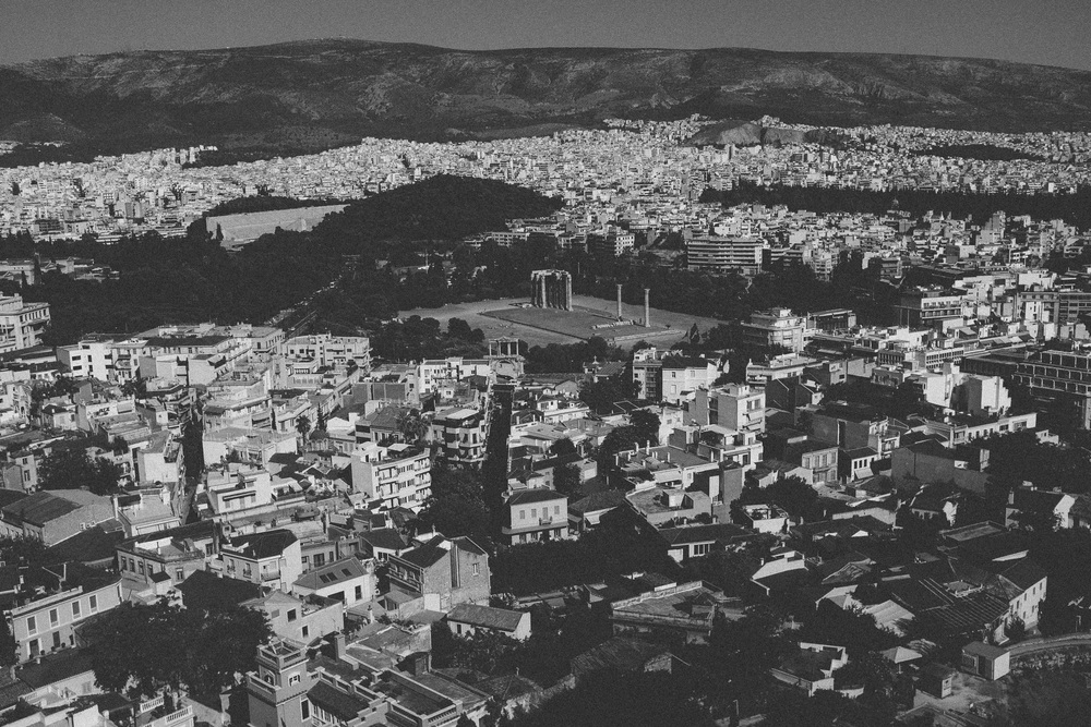 Photo 82. The ancient Olympieion Temple surrounded by modern Athens.  Athens, Greece, 2014.