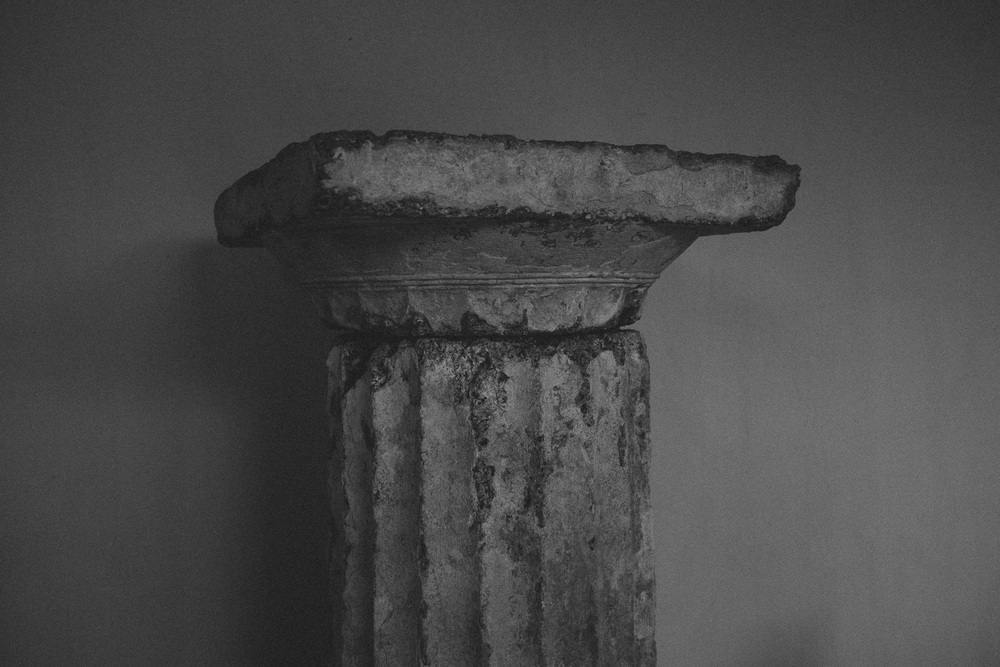 Photo 76.  This Doric capital is representative of one of three main architectural orders in ancient Greece.  Olympia, Greece, 2014.