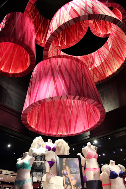 Over 400 giant custom made ribbon-wrapped lampshades in various shapes and sizes made for Victoria's Secret stores worldwide.