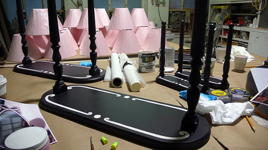 Production image of the hundreds of custom made, hand-painted mirrors and lamps.
