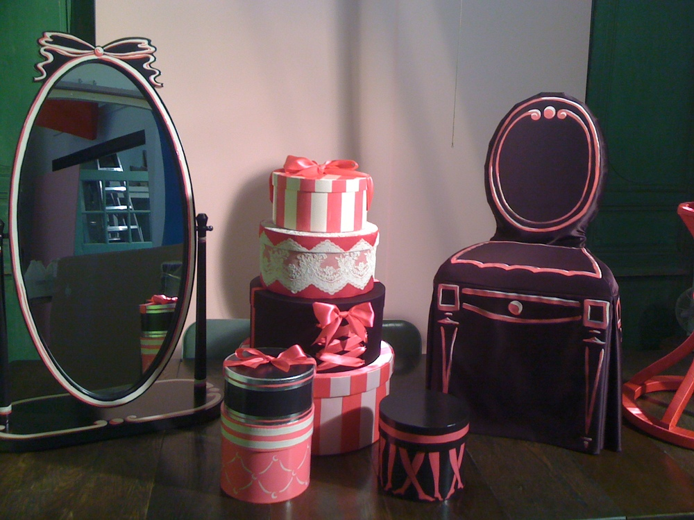 Hundreds of hand made mirrors, hat boxes and hand-painted fabrics for Victoria's Secret stores worldwide.