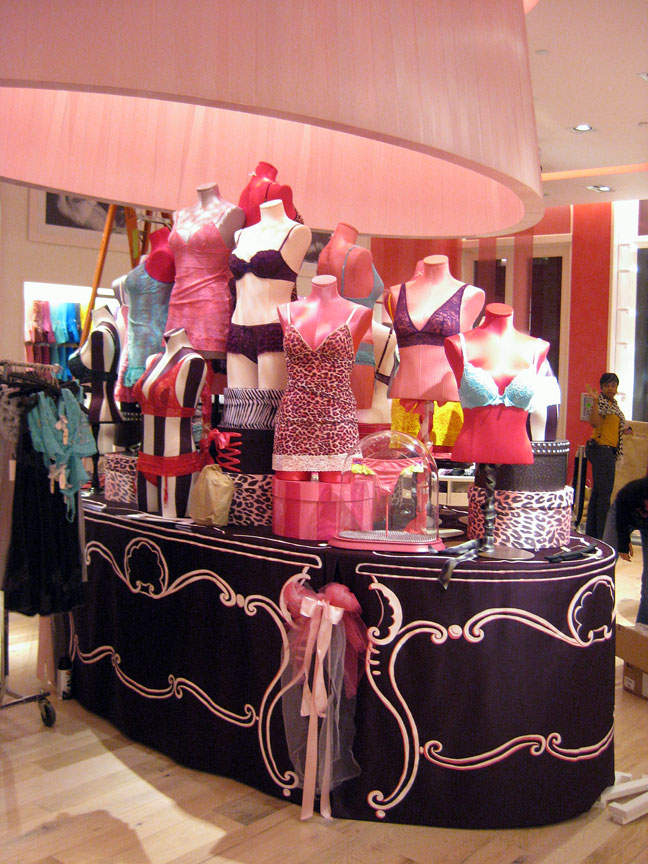 Giant ribbon wrapped lampshade, hand painted table skirts and hat boxes produced for Victoria's Secret stores worldwide.