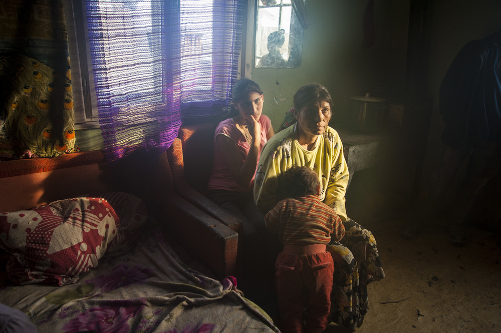 The Hendre family huddles in the warm hut as the smell of burning plastic fills the air.