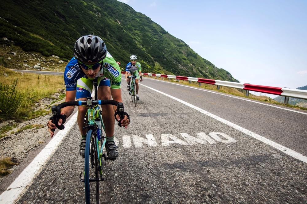 Timo Chiciudean (front) and Richard Wakeford, both amateur cyclists from the United Kindom, race down the seemingly endless set of switchbacks and hairpin turns that make up the Transfăgărășan's northern face on August 9, 2013. Considered by many as one of the greatest and most grueling stretches of road in the world, Romania's Transfăgărășan highway presents even the most seasoned cyclist with a real challenge.