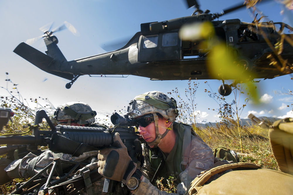 SPC. Ash Royal and members of the U.S. Army's 2nd Infantry Brigade Combat Team exit one of two Black Hawk helicopters during their air assault training exercise at Ft. Carson, Colorado on Monday, October 5, 2015. The assault exercise, which uses blank rounds that are designed to prepare soldiers for future combat situations, challenged the team with taking a compound held by soldiers from the 1st Battalion 12th Infantry Regiment.