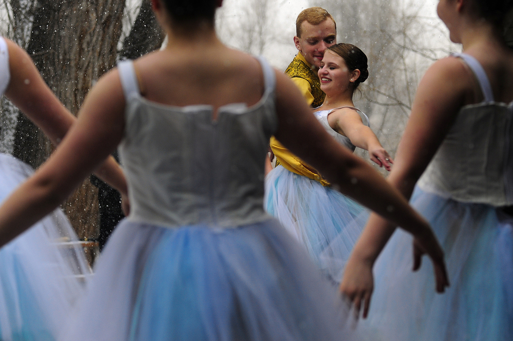 Kevin Scheffler and Emily Bryant, center, brave the cold and snow as they perform in the 2nd Annual Nutcracker in the Park at Sondermann Park in Colorado Springs, Colo., on Saturday, Dec. 12, 2015. The performance offered opportunities for spectators to learn about local wildlife.