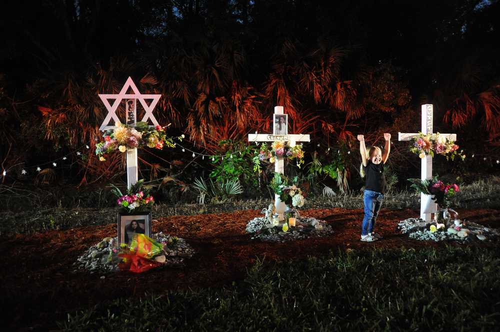 Jalissa Miani, 4, innocently plays at the memorial site where her mother, Marissa Miani (not pictured), lost five friends twenty years before in a car accident in suburban Boca Raton, Florida; February 23, 2016.