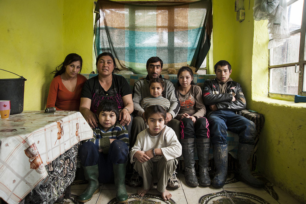 The Demian family poses in their living room in Cheriu, Romania on March 16, 2013.