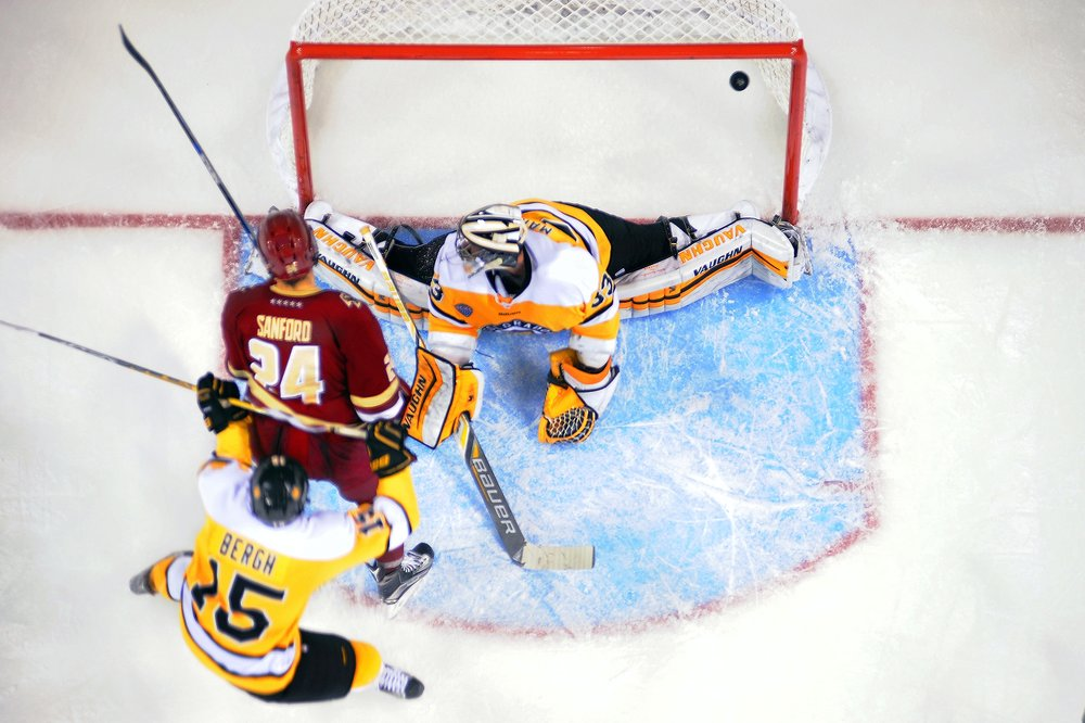 Boston College forward, Zach Sanford, 24, scores against  Colorado College goalie, Tyler Marble, 33, in the second period as the number four ranked Eagles defeat Colorado College 5-0 at the World Arena in Colorado Springs, Colo on Saturday, October 24, 2015. The Tigers failed to end their five-game losing streak after having been plagued by lineup issues following the loss of several players to injury and early departure.