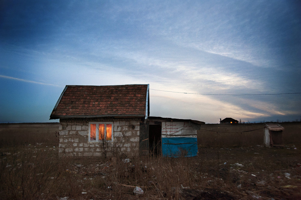 Windows glow as a small hut in Cheriu gets electricity for the first time.