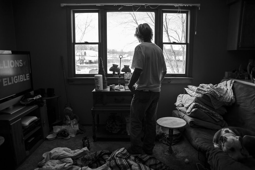 Richard, Nathan's father, collects some items from the family's home just outside of Jackson, Ohio on February 12, 2014, after a fire in Nathan's closet spread and caused smoke and water damage throughout most of the home. Nathan's family was forced to live in a nearby hotel for several weeks after the fire.