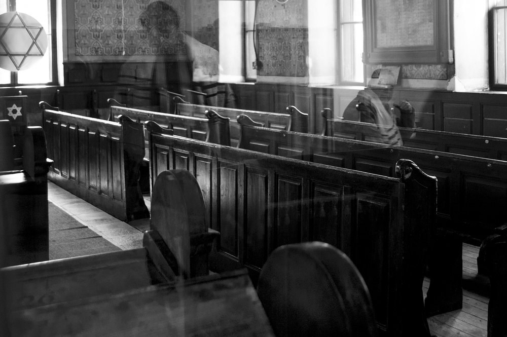 During the weekly Torah reading in Oradea, Romania's last functioning synagogue, reflections fill the empty Sas Chevra Synagogue sanctuary like reminders of a former community; April 11, 2013. Most of the over 30,000 Jews from Oradea at the time of the war were deported to Nazi camps across Europe.