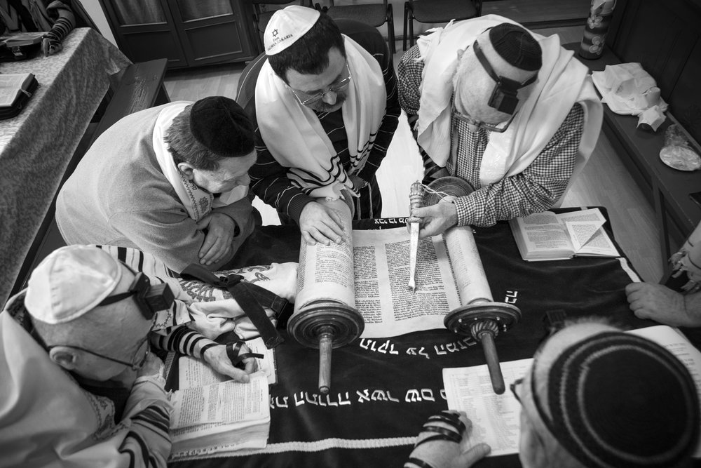 Male members of the Jewish Community Center in Oradea, Romania meet on April 11, 2013, for their weekly reading of the Torah, the Jewish holy book. Though the once thriving community of thirty thousand was devastated by the Holocaust, the few remaining members continue to carry on the ancient Jewish religious traditions.