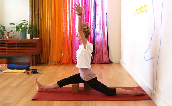 Hanumanasana with a block under belly of hamstrings