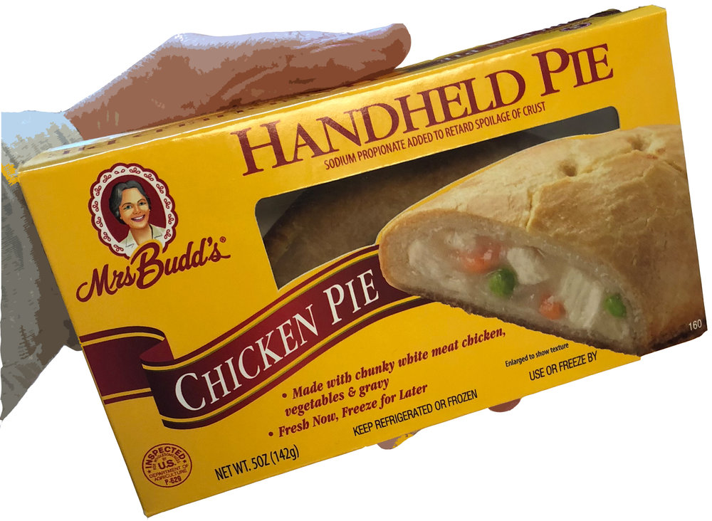 chicken handheld with hand.jpg