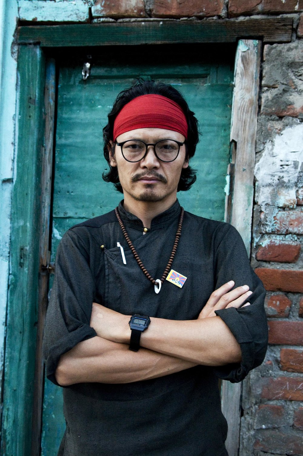 "Tibetan activist and writer Tenzin Tsundue is known for his darig protests including scaling 14 floors of a Mumbai hotel to unveil a ""Free Tibet"" banner in 2005."