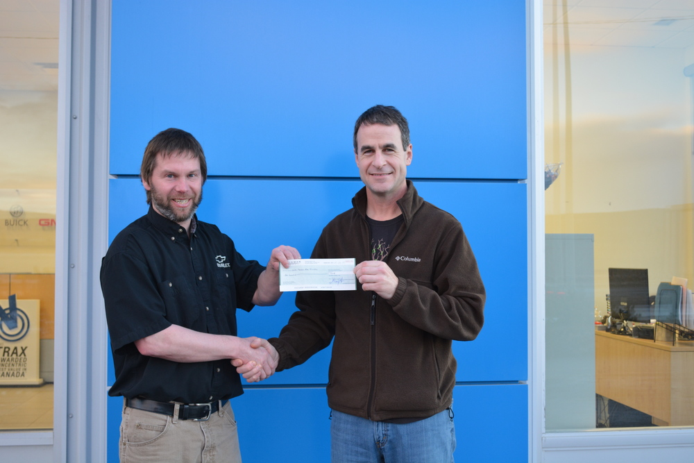 Shawn, HMBA President (left),  accepting the donation from Talisman employee, Colin Hanington (right).