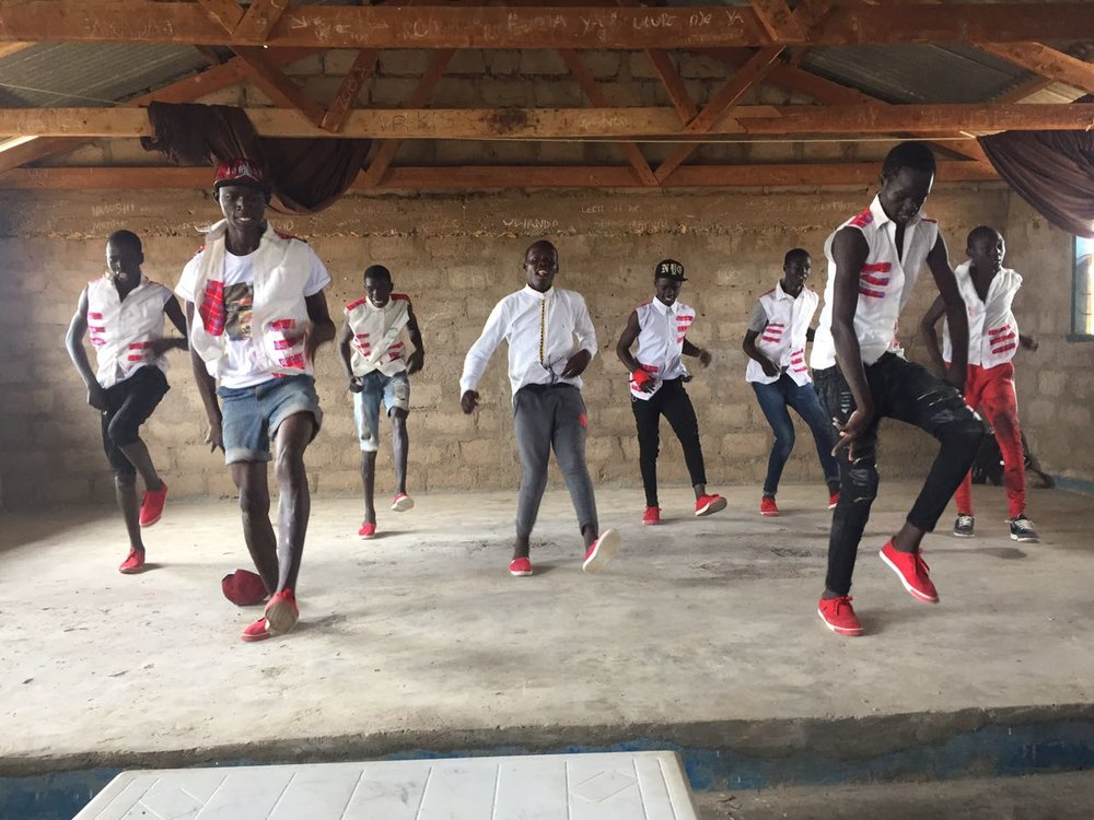 Today there are many more primary schools, secondary schools and youth programs, which are educating thousands of refugees from South Sudan. One of these programs is the Youth and Culture Program that Valentino helped to run when he was there. (Above: A well-known youth dance troupe performs the welcoming dance.)