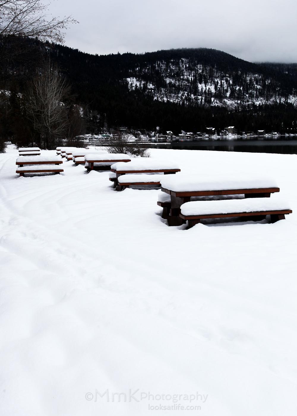 Picnic tables waiting for the spring melt - Christina Lake, BC.