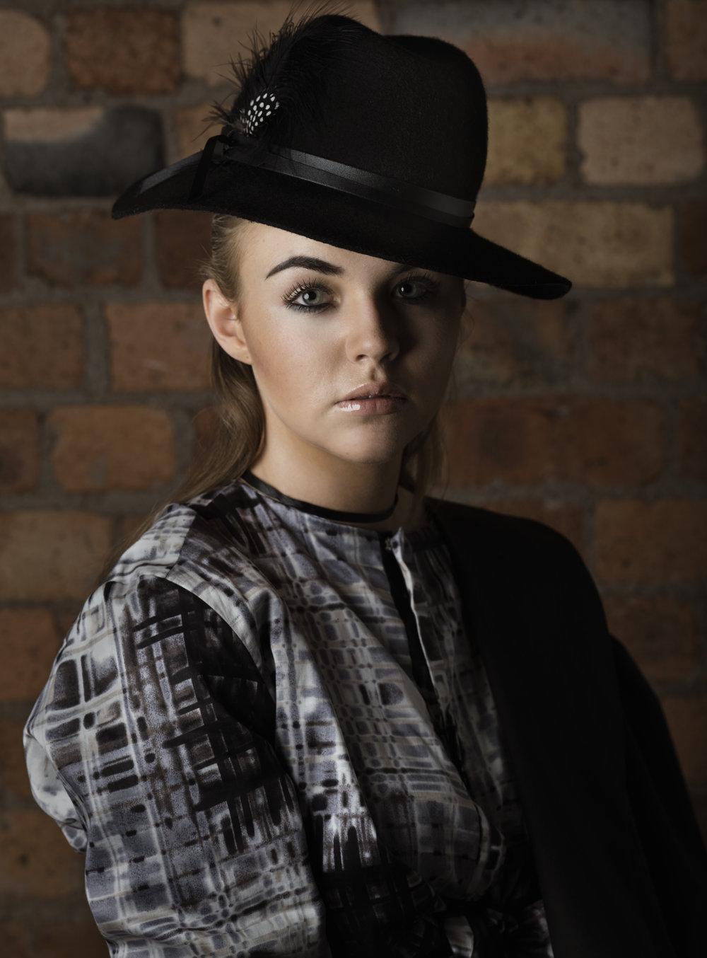 zaramia-ava-zaramiaava-leeds-fashion-designer-ethical-sustainable-glasses-versatile-drape-wrap-top-wrap-top-jacket-mio-black-white-grey-styling-hat-studio-womenswear-photoshoot-8