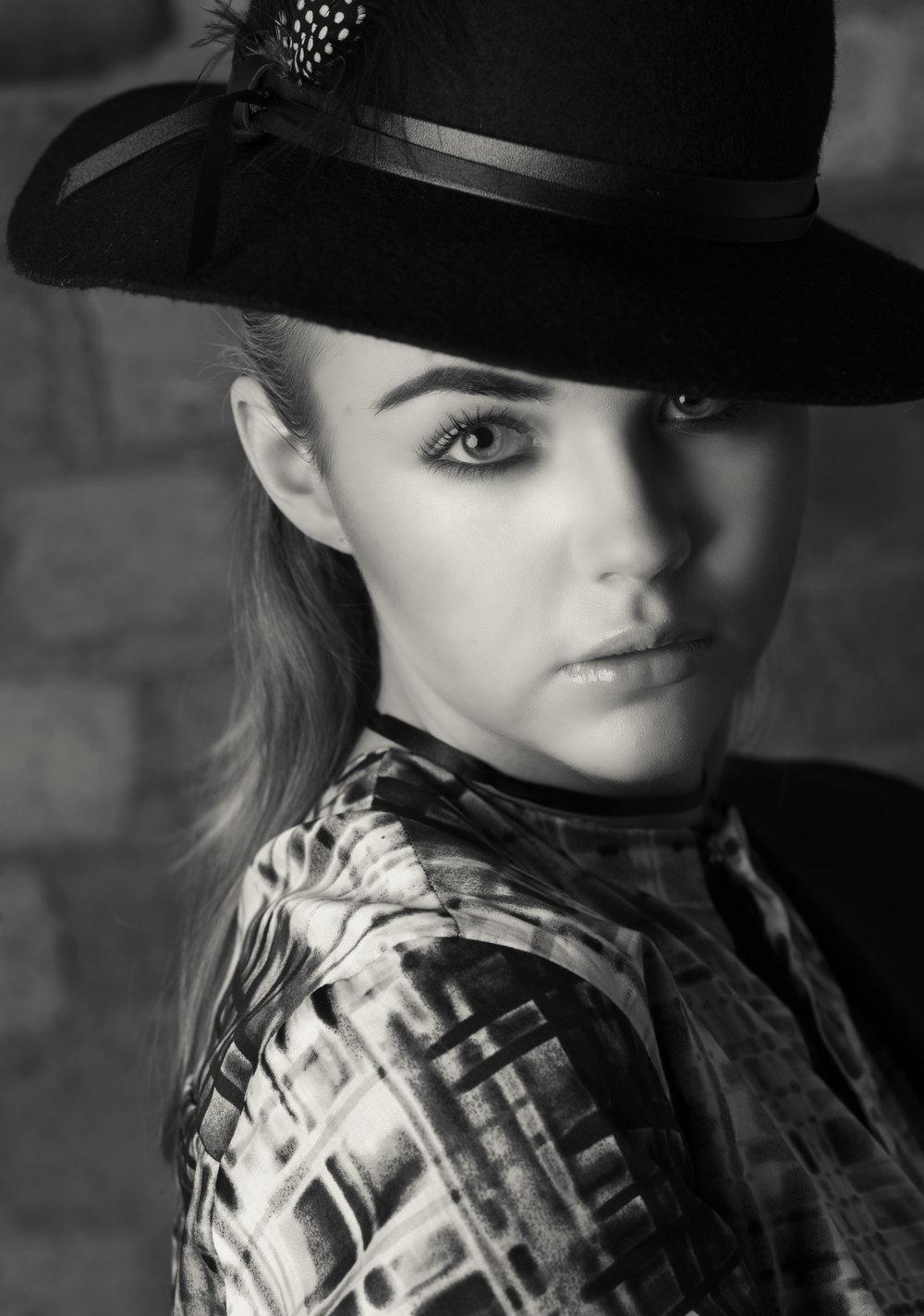 zaramia-ava-zaramiaava-leeds-fashion-designer-ethical-sustainable-glasses-versatile-drape-wrap-top-wrap-top-jacket-mio-black-white-grey-styling-hat-studio-womenswear-photoshoot-9