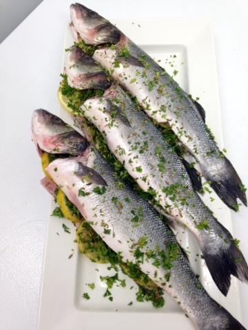Whole Bronzini Seasoned with lemon, parsley, and fennel seeds.