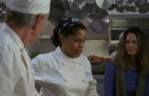 Dr. Miller working as a sous-chef right before she is admitted to the hospital with a life threatening condition.