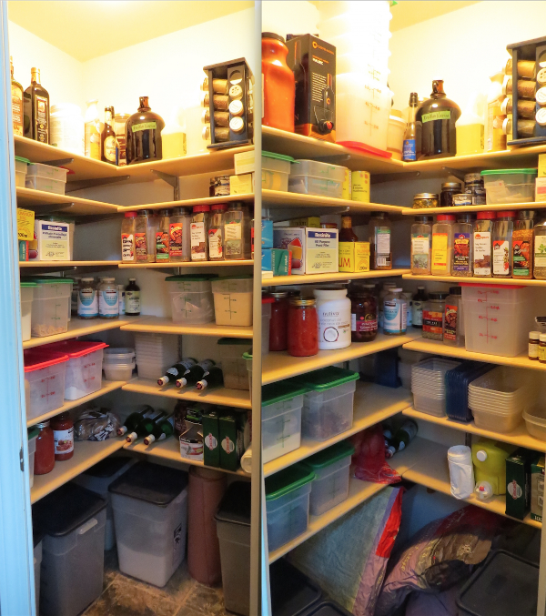 The pantry is where I managed to make progress. You can tell by the stacks of empty containers on the top shelf and on the middle right. The big bags below the shelving are dog food for our foster that we were able to procure at a large one-time discount, so we stocked up.