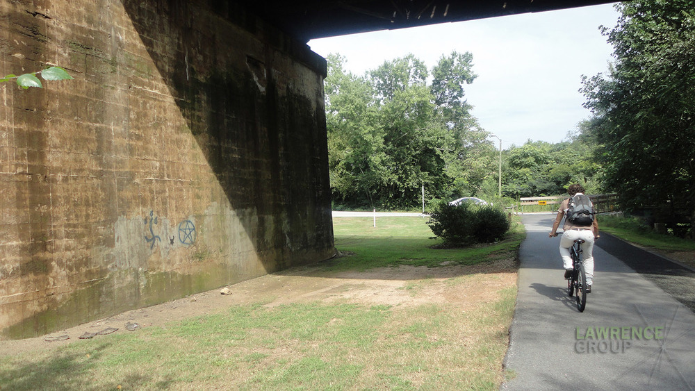 Before : The Swamp Rabbit Trail crosses under a train bridge. It's an unmemorable moment on the trail.