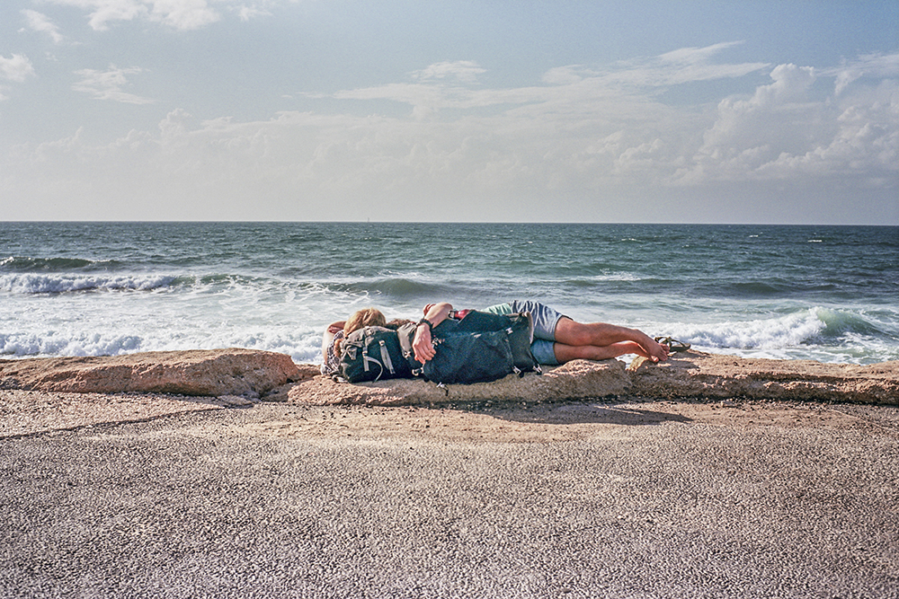 Backpacker Couple resting by the beach in Tel-Aviv_web.jpg