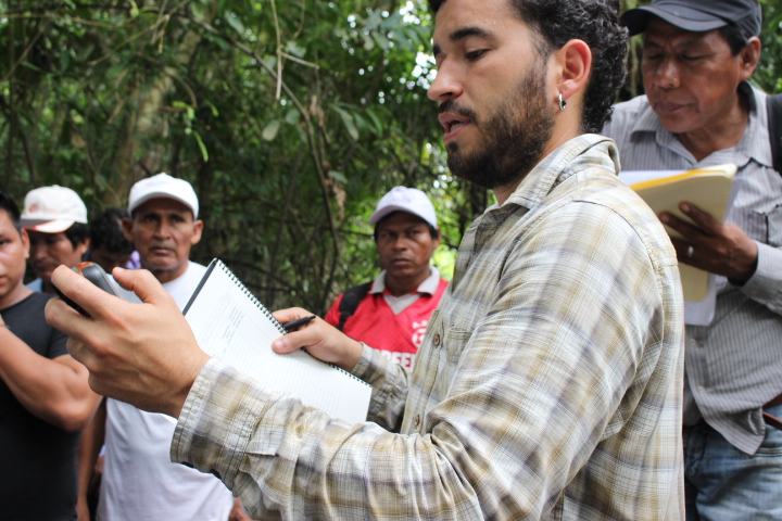 E-Tech field coordinator Ricardo Segovia takes a GPS reading for an augur sample