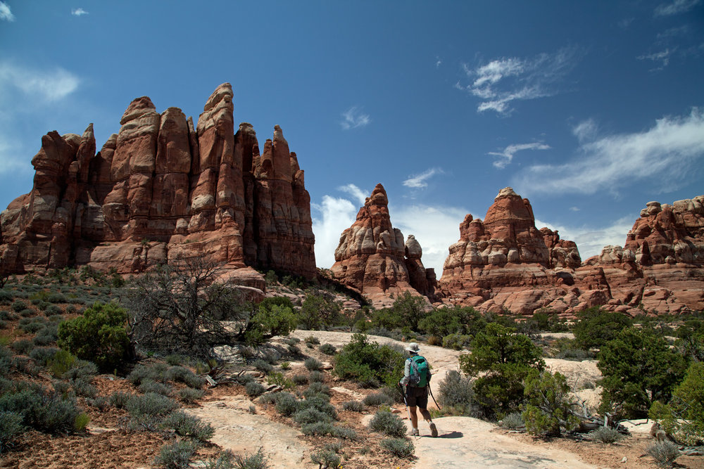 Terry trekking about the Needles District. Park visit  #8 .