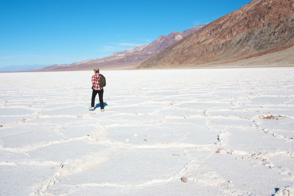 Terry trekking across the salt flats at Badwater Basin. Park visit  #33 . (Notice her apparel. We didn't visit in August!)