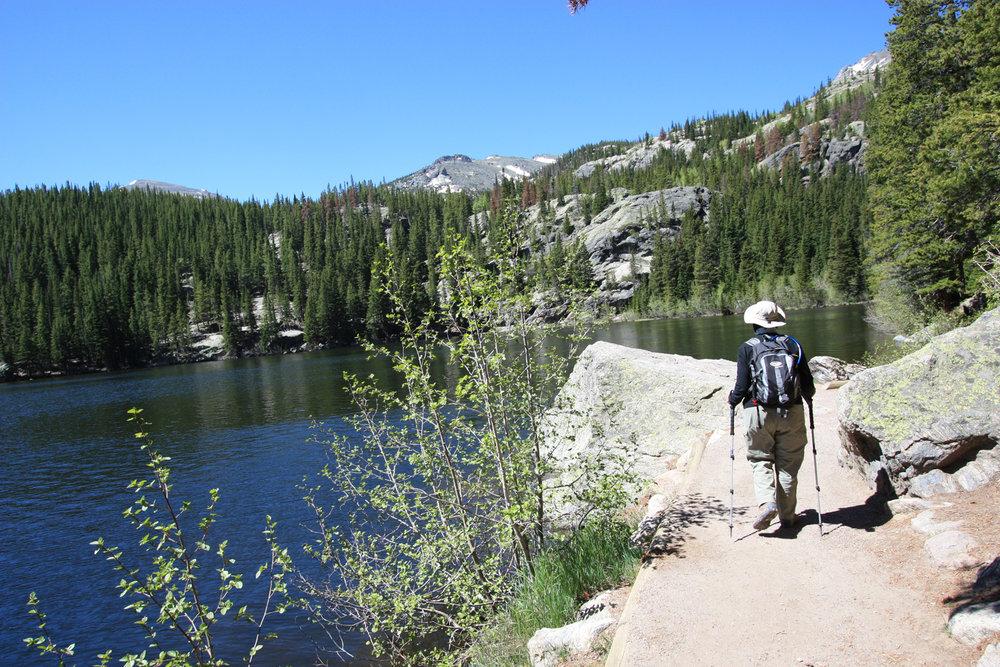 Terry trekking along Bear Lake shoreline during our  9th  park visit.