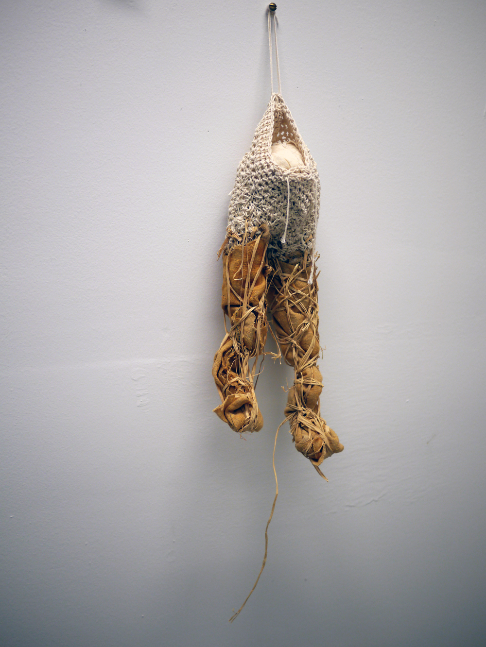 "Sarah Hewitt.  It . crocheted and woven cotton cord, raffia, rust dyed hemp, muslin. 24"" x 5"" x 3.5"". 2013."