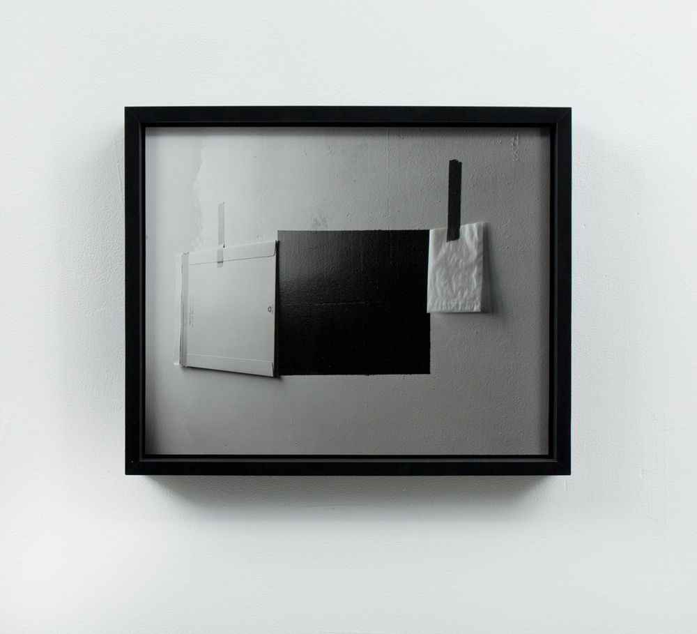 Negative #1 (mailing envelope, black paint, white paint, 4x5 glassin film, envelope, red and yellow masking tape)   Gelatin silver print mounted and framed  Edition 1 0f 2, 1 artist proof  15.5 inches x 18.5 inches  2013-2016