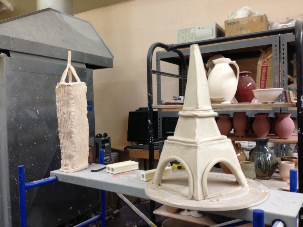 Next generation: Bisque-fired works by Ben and LoriAnn Owen's young daughter and son await glazing, December 2014.