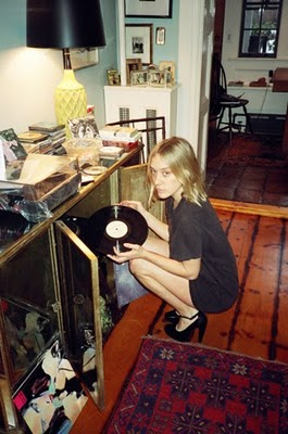 Chloe listening to records