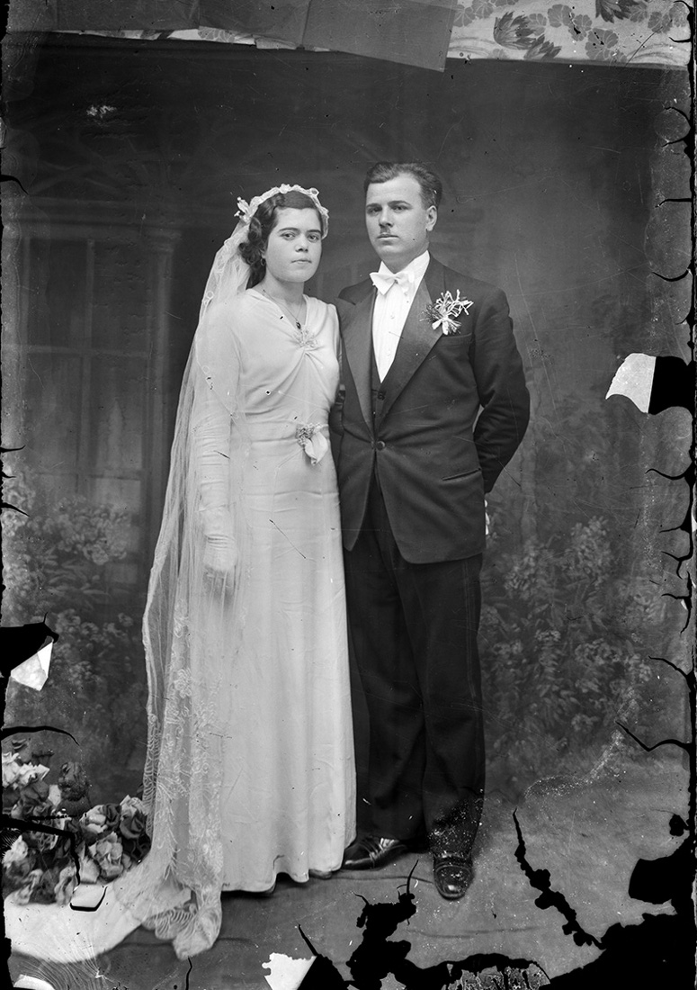 Vintage Romanian bride and groom on their wedding day. Photo by Costica Acsinte.