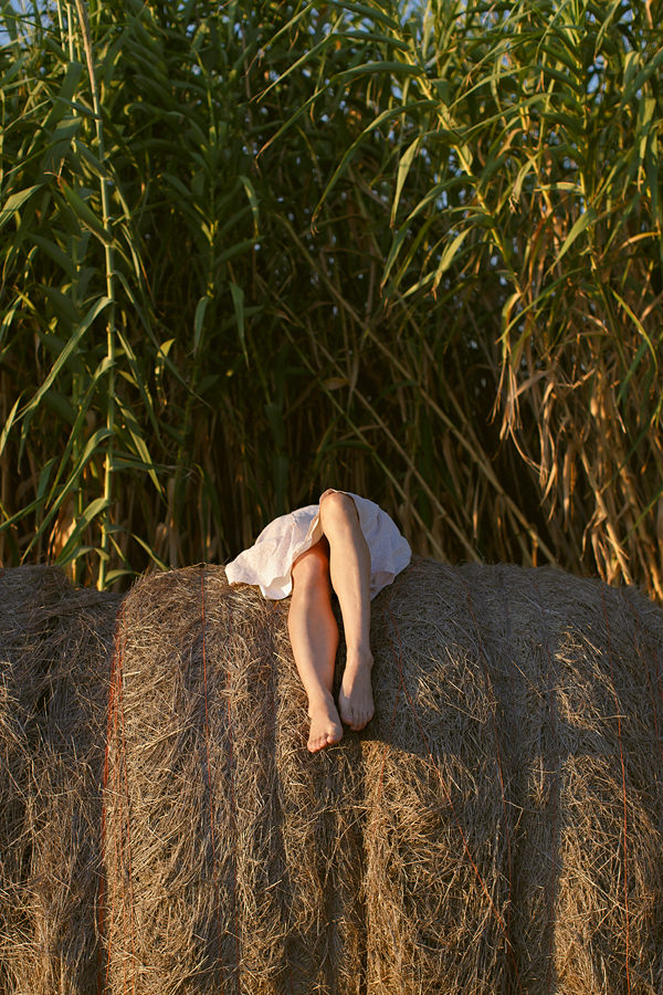 Golden hour in Texas with Dalena VIntage, bales of hay and a Depression Era dress. Photo by Nicole Mlakar.