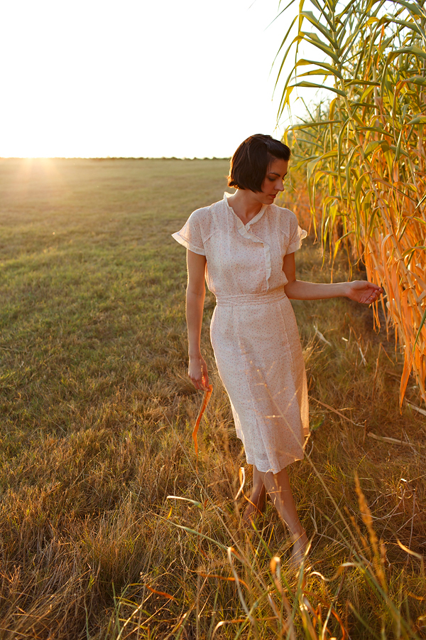 Golden hour in Texas with Dalena VIntage, bales of hay and a vintage Depression Era dress. Photo by Nicole Mlakar.