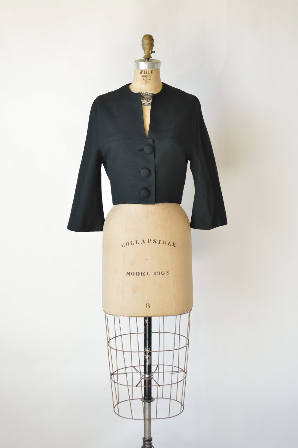 Vintage 1960s black cropped jacket by Herman Marcus from online vintage shop, Dalena Vintage.
