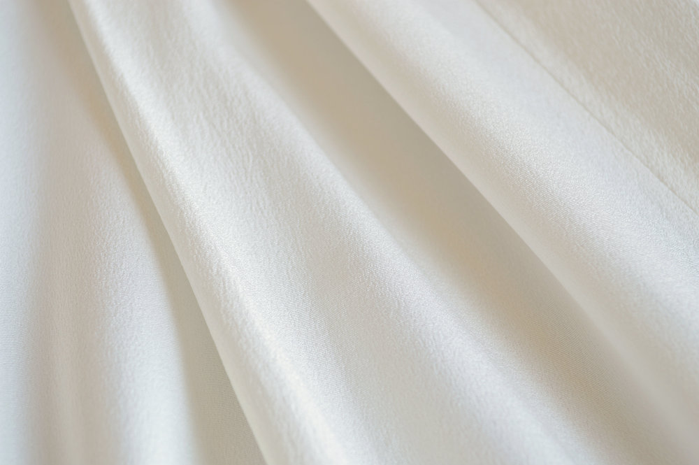 Cream rayon exterior of a 1940s DuBarry wedding dress.