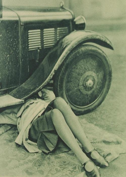 Flapper under a car, 1920s