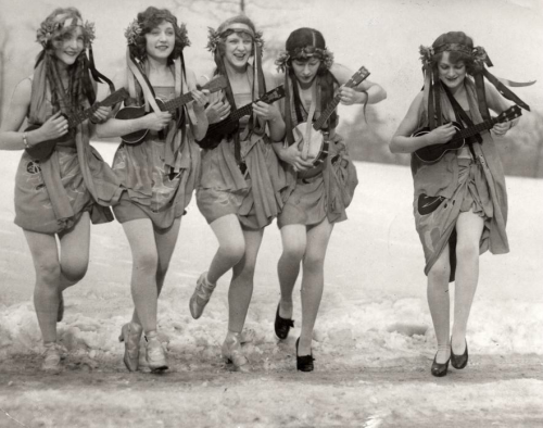Girls playing ukes on the beach, 1920s