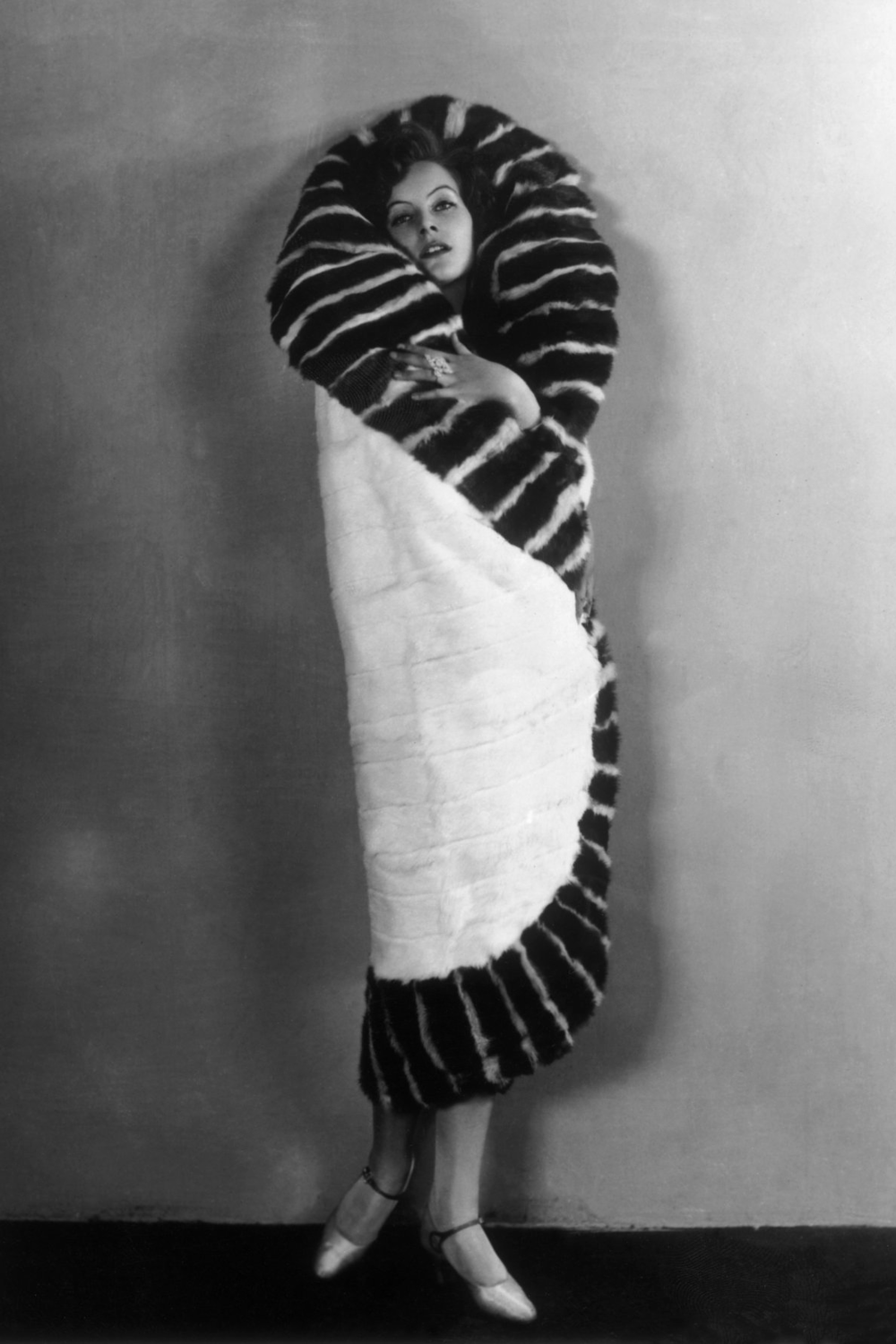 Vintage style icon, Greta Garbo, in a 1920s cocoon coat.