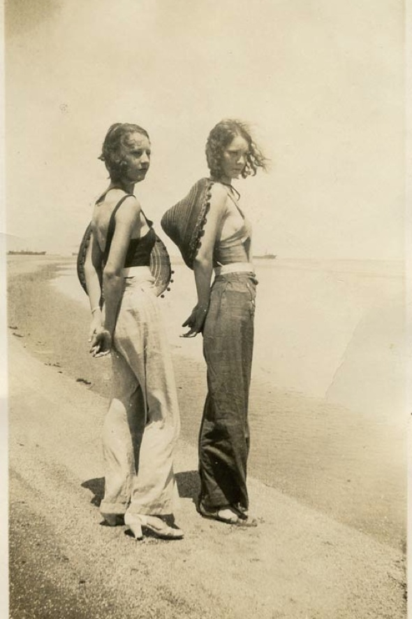 Vintage beach style. Two women on the beach near a naval base during WWII. Image via The Sartorialist.