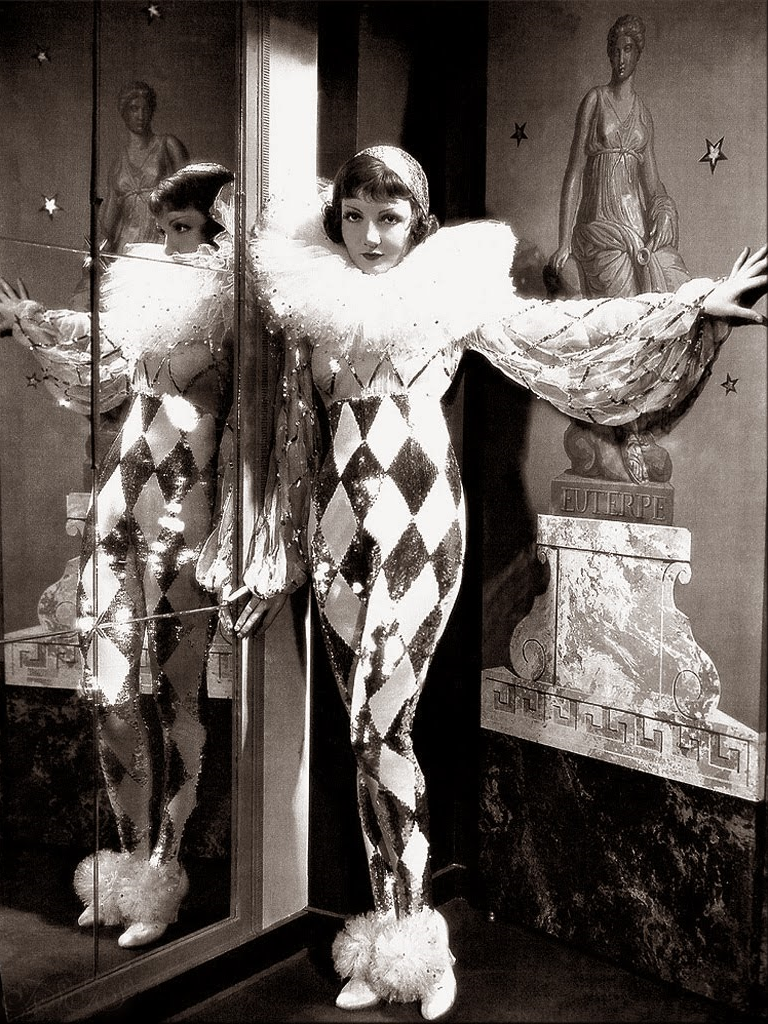 Claudette Colbert as a harlequin clown