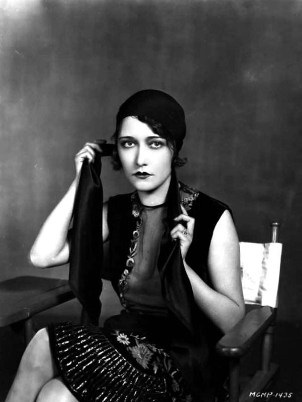 Dorothy Sebastian tying a turban in the 1920s.
